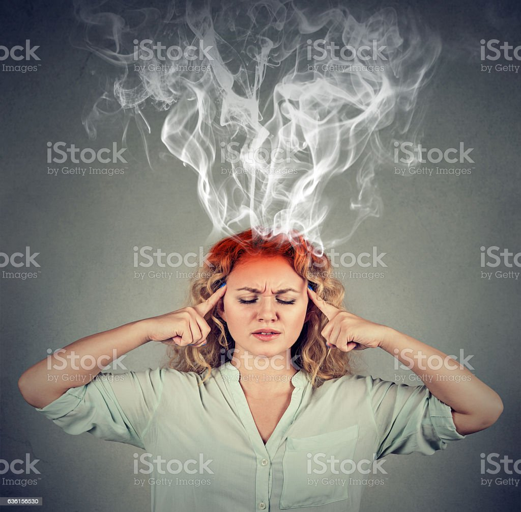 Woman thinks very intensely having headache stock photo