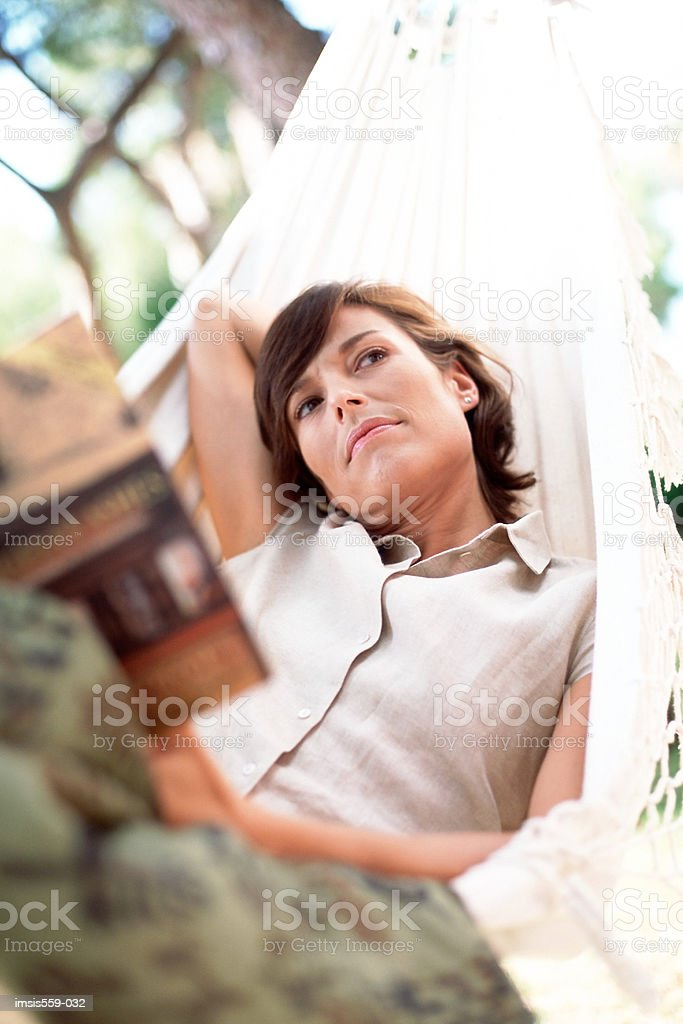 Woman thoughtful in hammock royalty free stockfoto