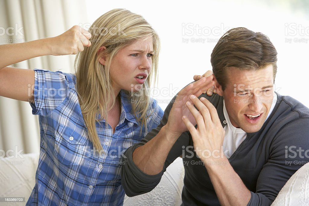 Woman Threatening Man During Argument stock photo