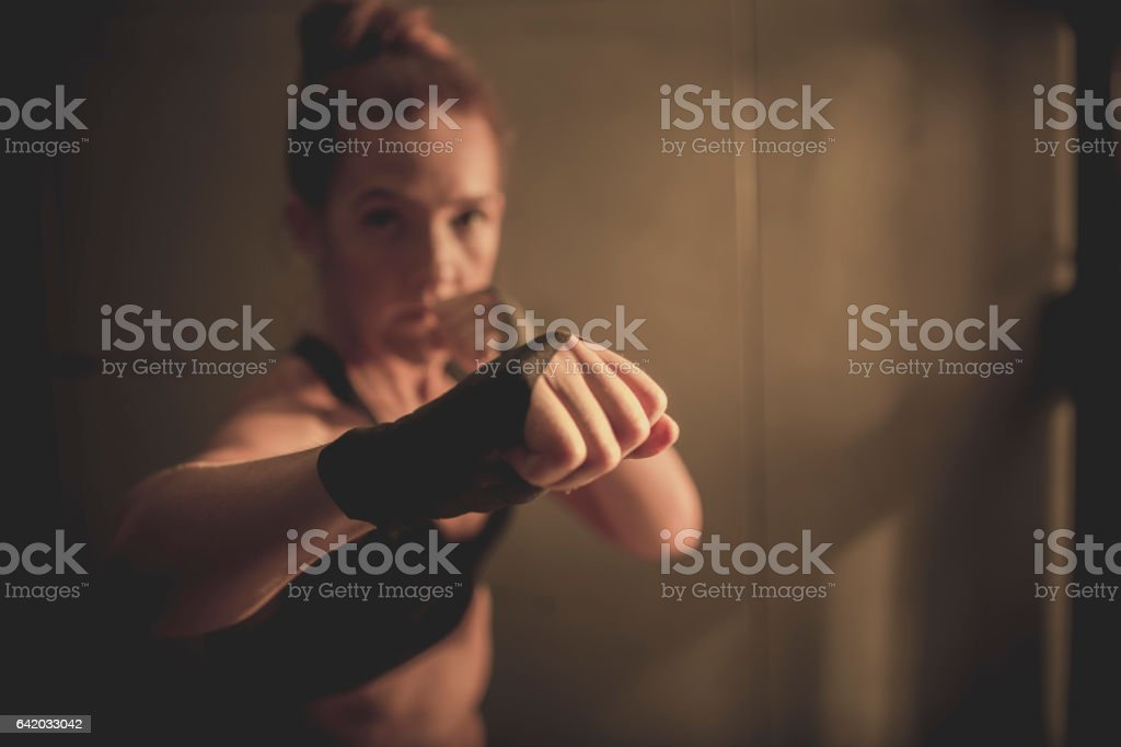 Woman Throwing a Punch stock photo
