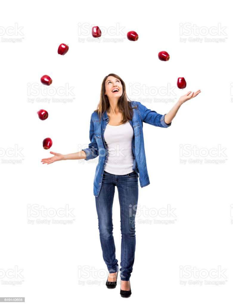 Woman throwing apples stock photo