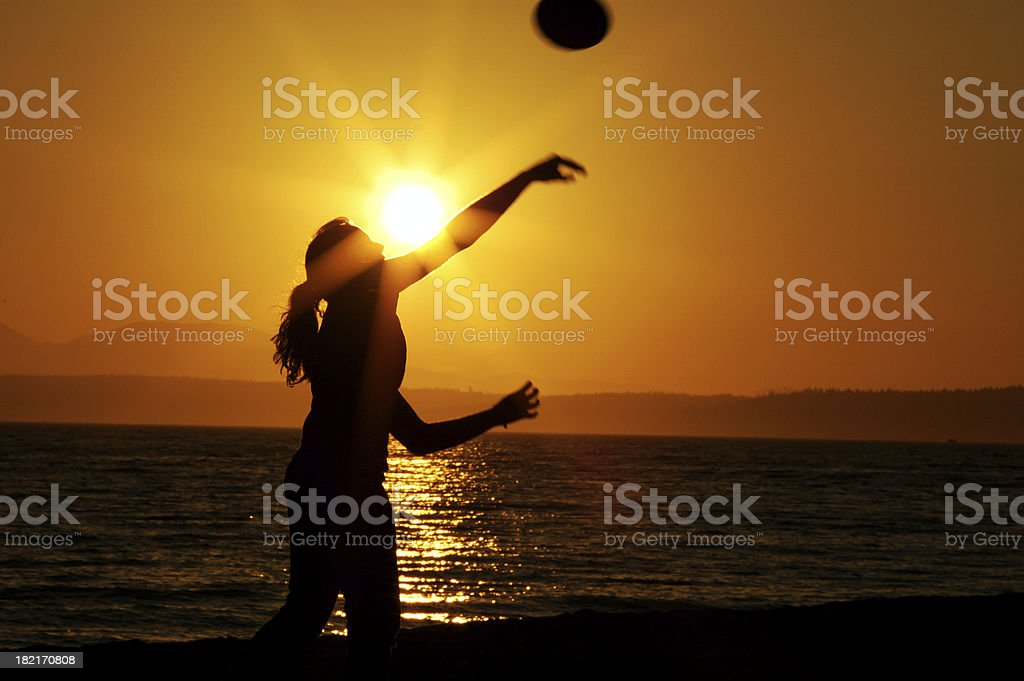 Woman Throwing Football at Sunset royalty-free stock photo