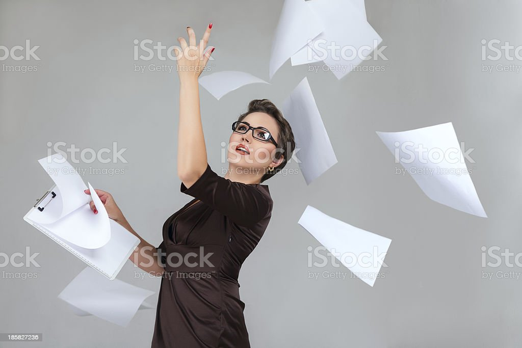 Woman throwing paper pages royalty-free stock photo