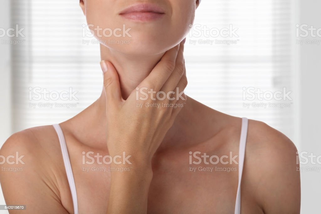 Woman thyroid gland control isolated on white background stock photo