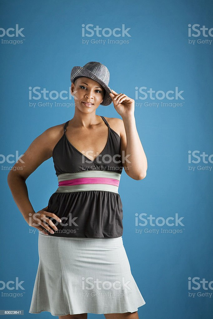 Woman tipping hat royalty free stockfoto
