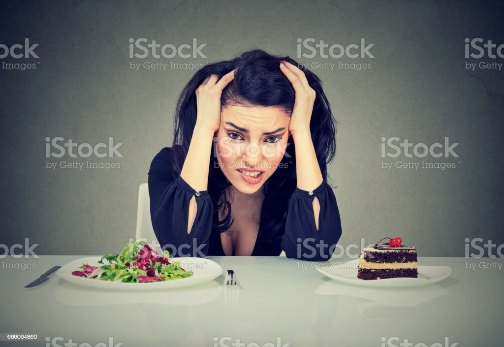 Woman tired of diet restrictions stock photo