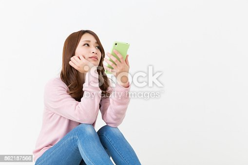 istock woman to see a smart phone, think, 862187566