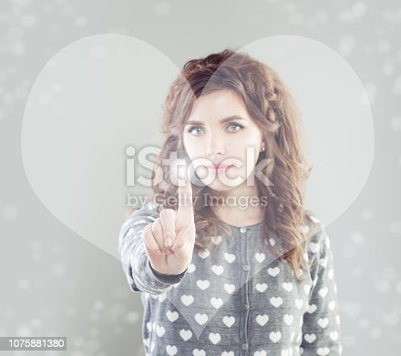 Woman touching heart symbol virtual display