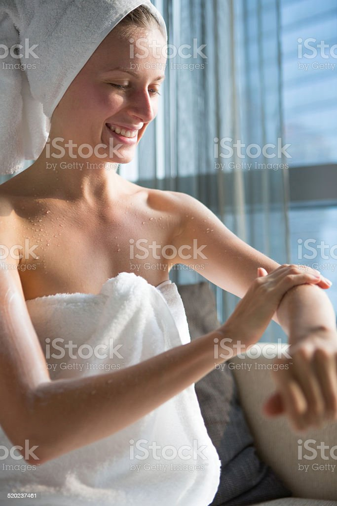 Woman touching her arm stock photo