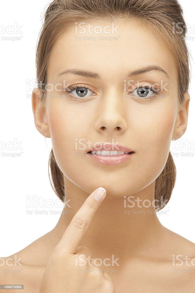 woman touching her chin stok fotoğrafı