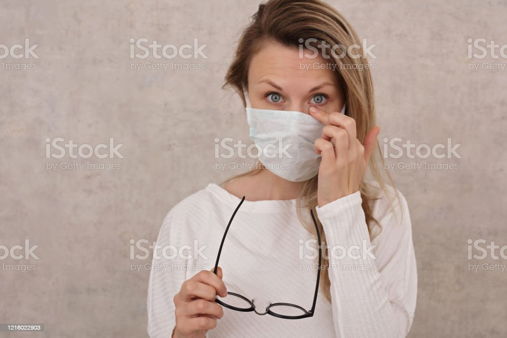 Woman touching her face, eyes. Coronavirus Prevention, New habits, Self-Isolation , Quarantine Man touching is face, eyes. Coronavirus prevention, New habits, Self-isolation , Quarantine Adult Stock Photo