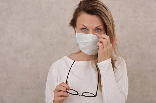 Woman Touching Her Face Eyes Coronavirus Prevention New Habits Selfisolation Quarantine Stock Photo - Download Image Now