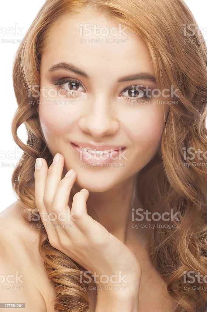 Woman touching her face royalty-free stock photo