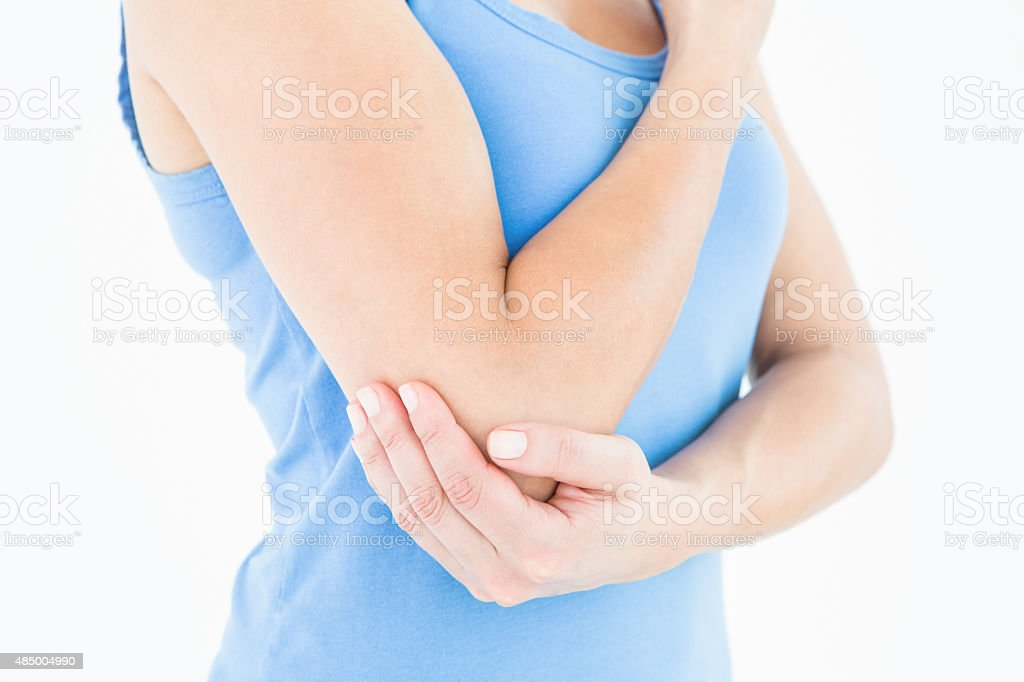 Woman touching her painful elbow stock photo