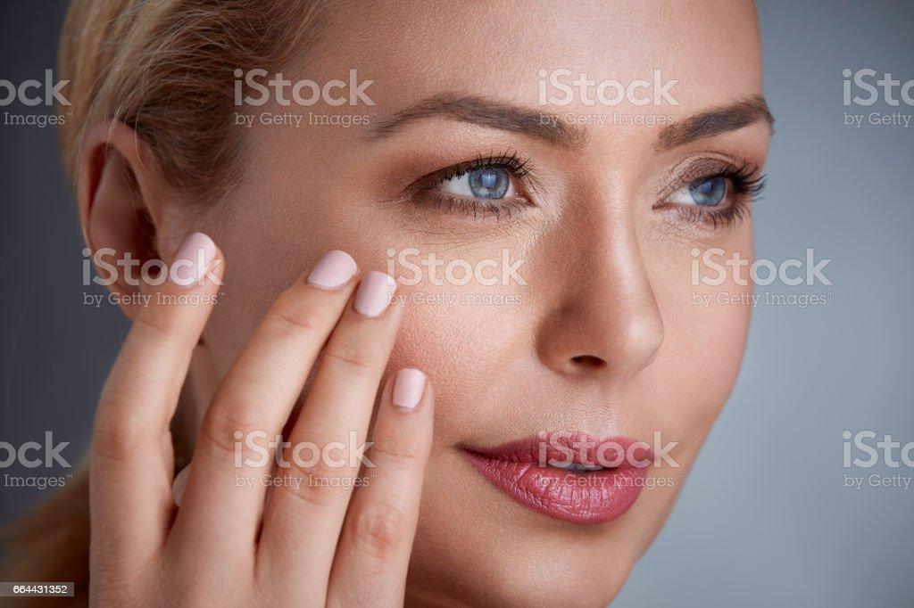 woman touching her skin stock photo