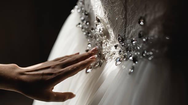 Woman touching her wedding dress stock photo