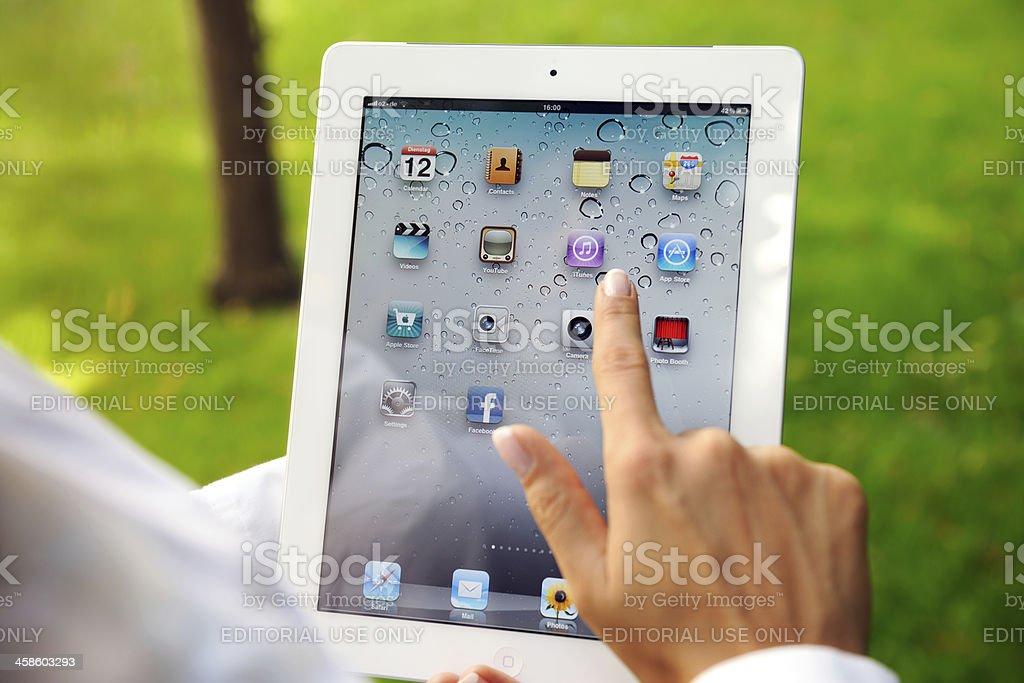 Woman Touching iPad2 Homescreen royalty-free stock photo