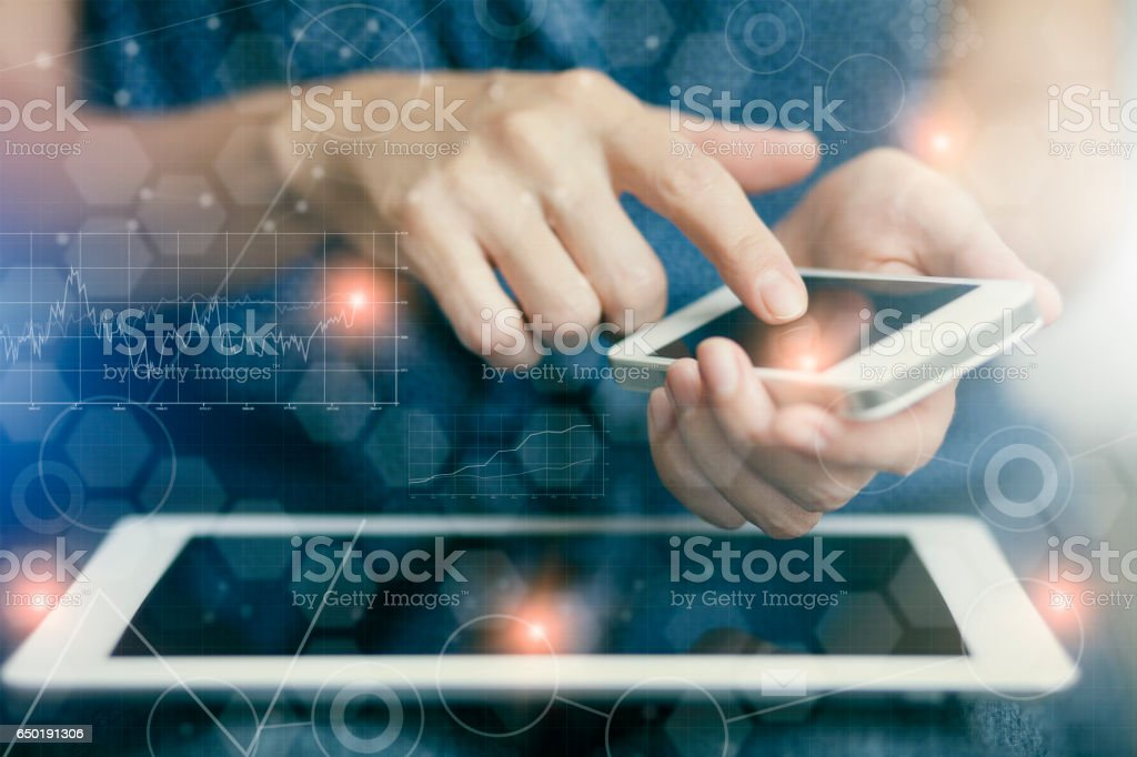 Woman touching screen of smart phone stock photo