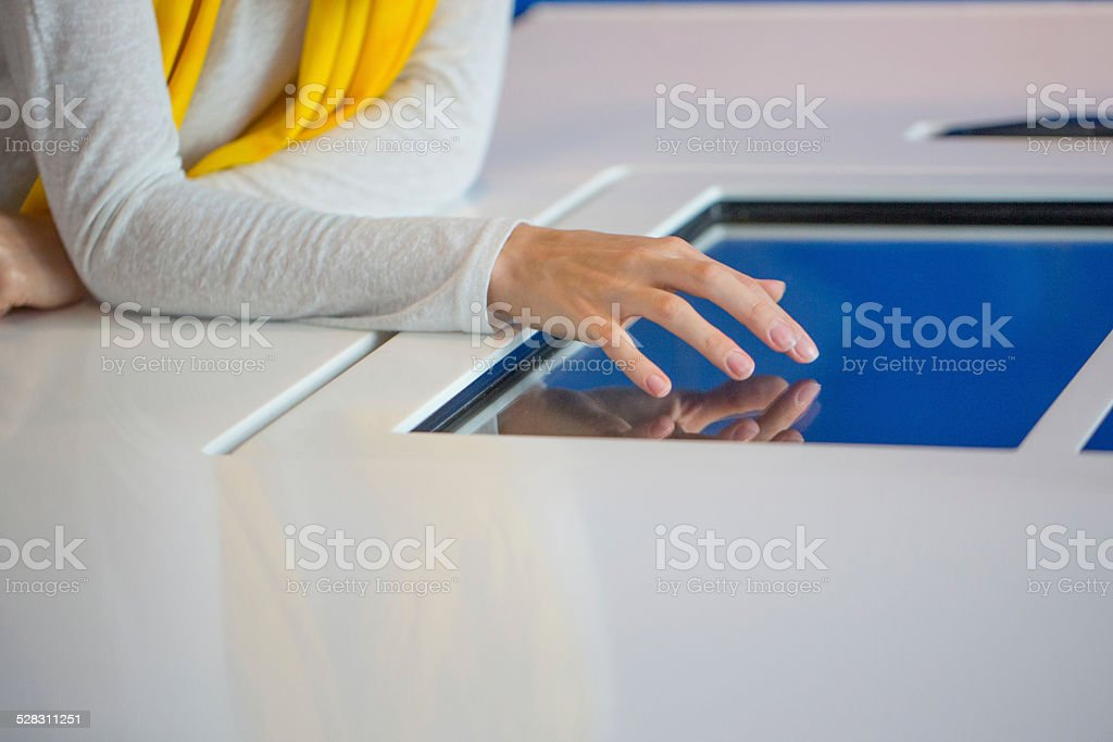Woman touching screen stock photo