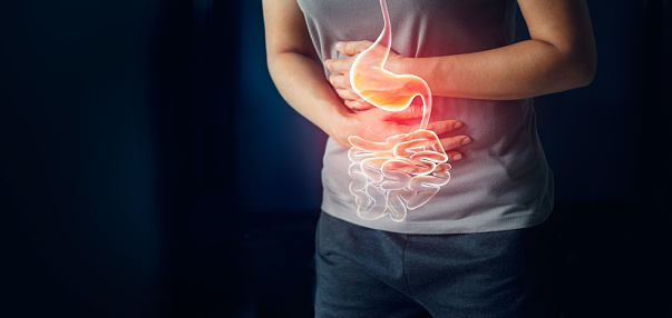 istock Woman touching stomach painful suffering from stomachache causes of menstruation period, gastric ulcer, appendicitis or gastrointestinal system disease. Healthcare and health insurance concept 1023232572
