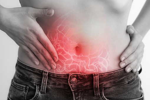 Woman touching stomach painful suffering from stomachache causes of menstruation period, gastric ulcer, appendicitis or gastrointestinal system disease. Healthcare and health insurance concept