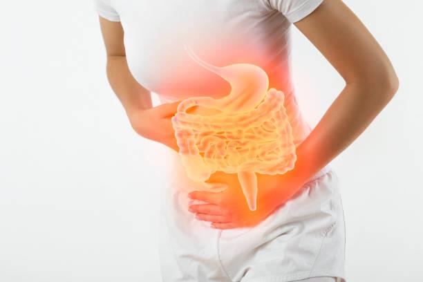 Woman touching stomach stock photo