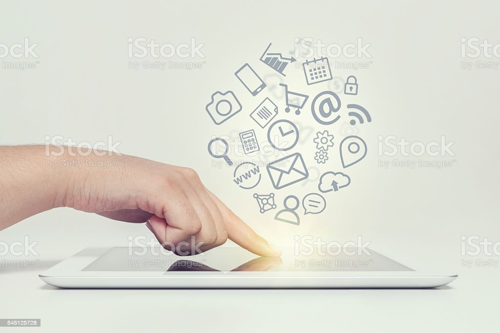 woman touching tablet computer screen and media icons fly – Foto