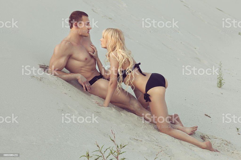 Woman touching the muscle men. stock photo