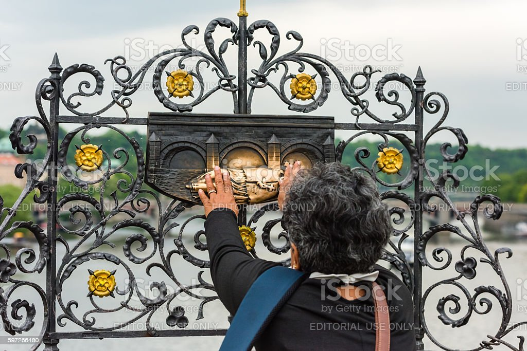 Woman touching the sculpture royalty-free stock photo