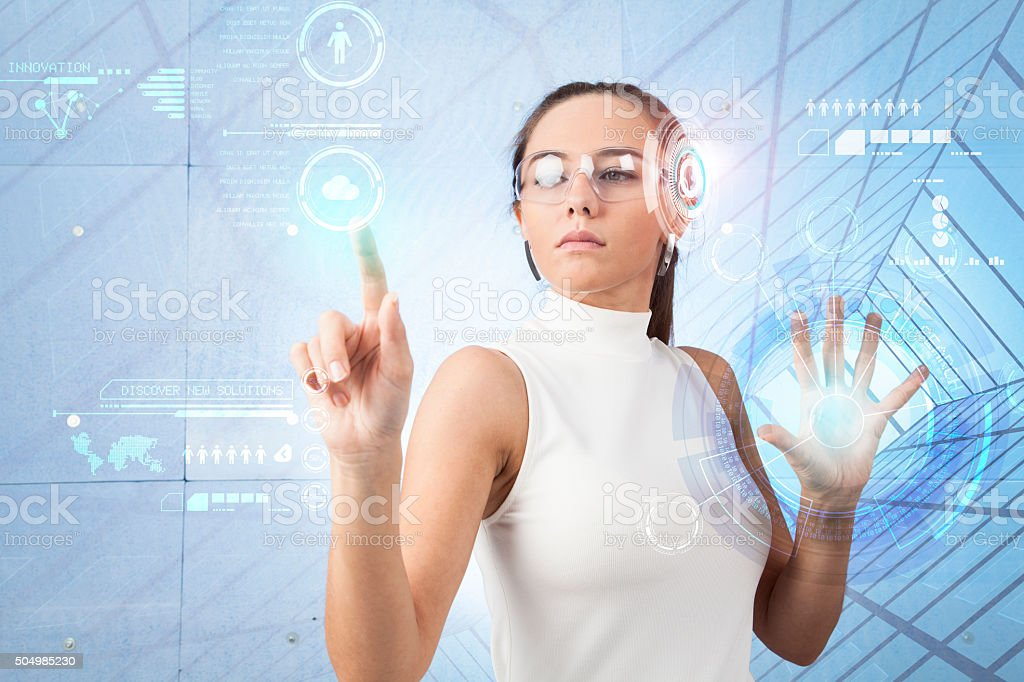 Woman touching the virtual future interface stock photo