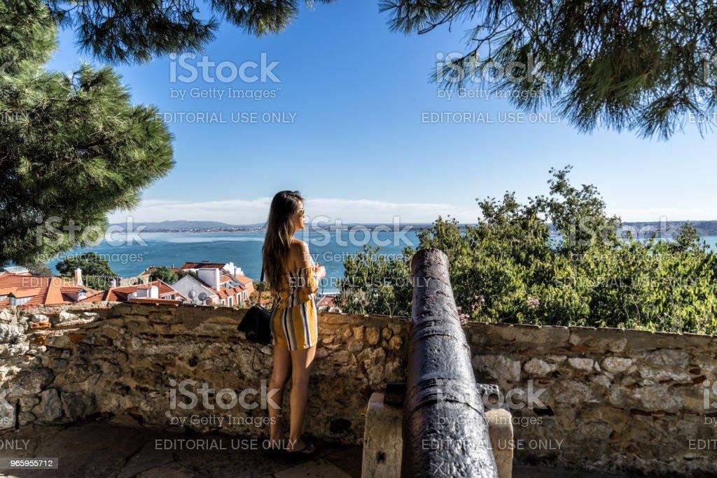 Woman tourist atop the Fernadina Wall fortress - Lisbon Portugal. - Royalty-free Adult Stock Photo