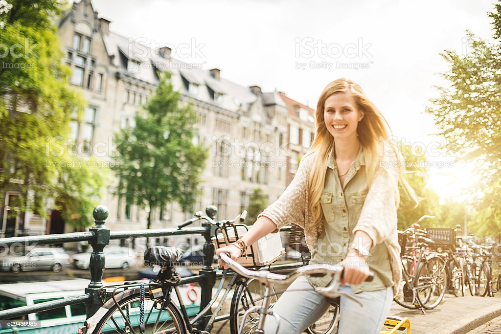 woman tourist cycling on amsterdam stock photo