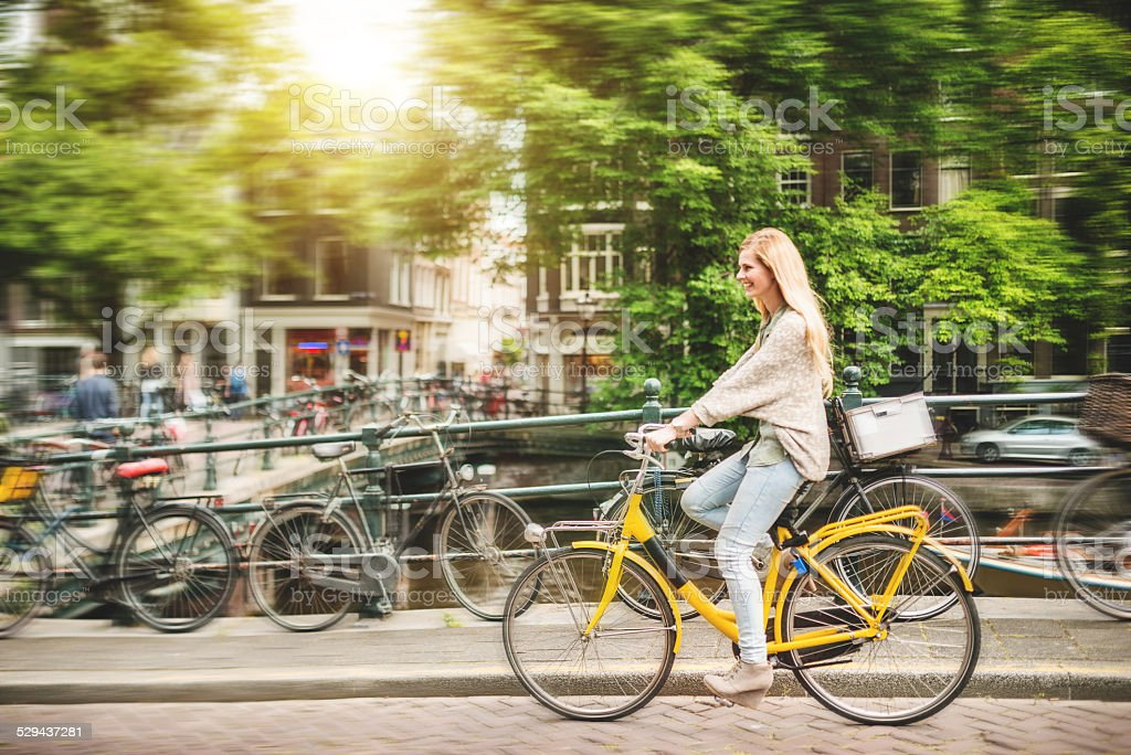 woman tourist cycling on amsterdam stock photo