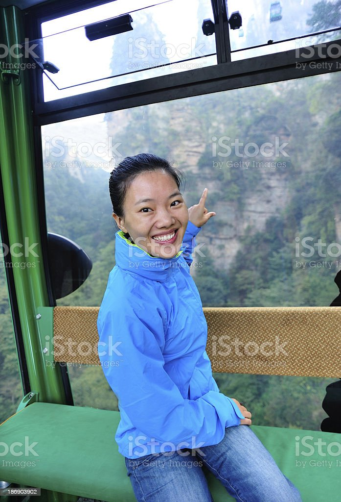 woman tourist in the cable car,zhangjiajie national forest park royalty-free stock photo