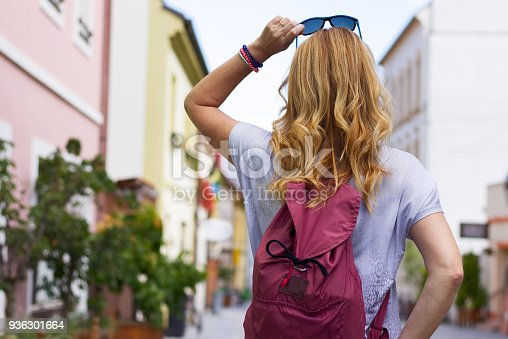 Blond hair hipster girl holding a sunglasses