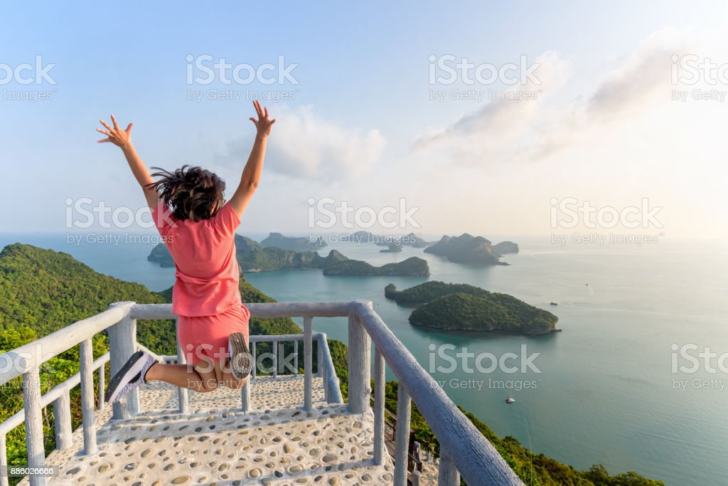 Woman tourist on peak viewpoint of island stock photo