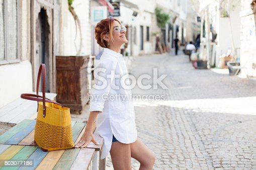 Woman tourist on the street traveling
