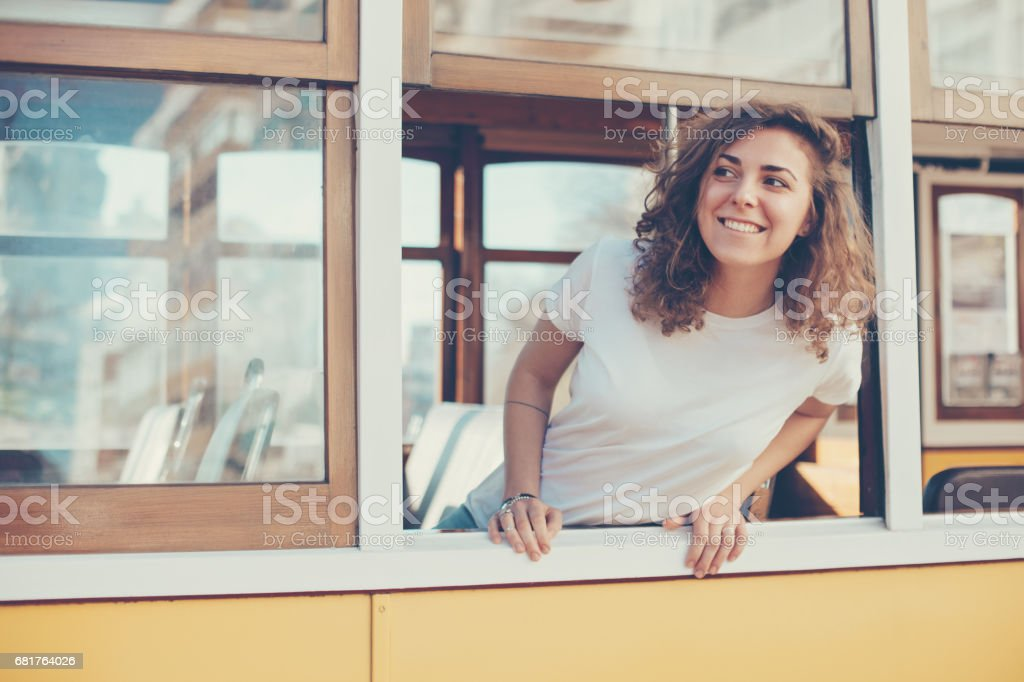 woman tourist taking a ride on the old vintage bus in foreign country stock photo