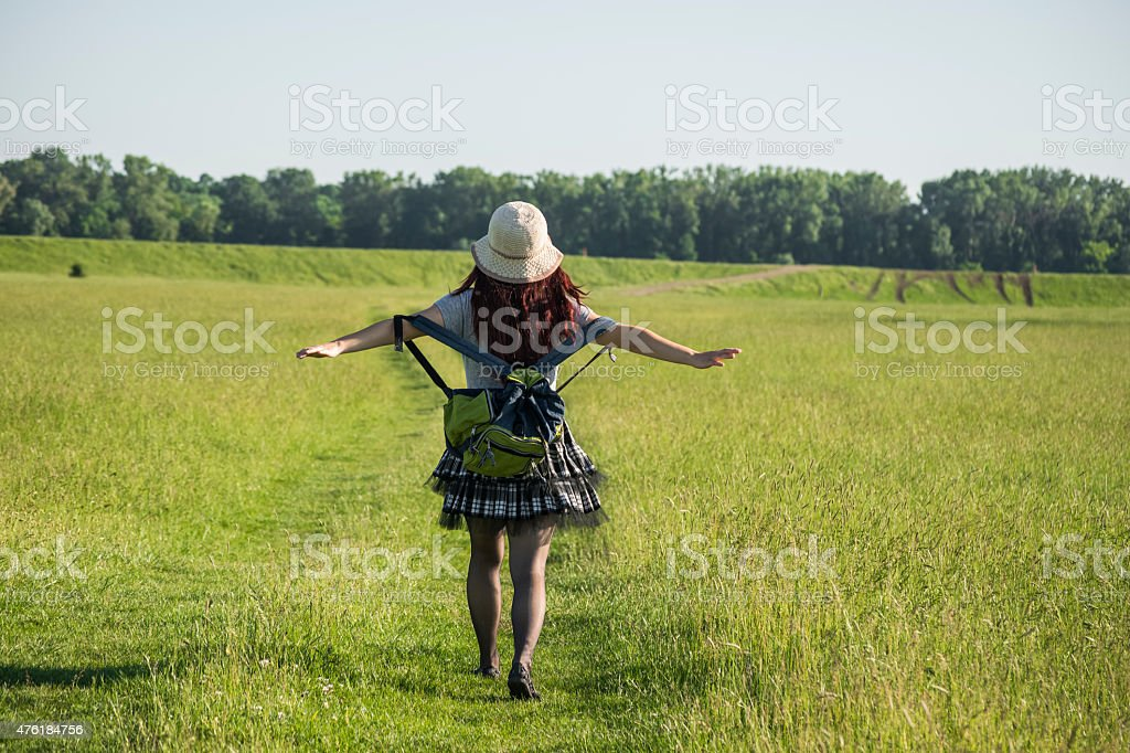 Woman tourist traveling alone with stretched hands stock photo