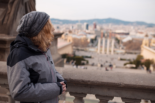 Woman tourist watching the landmarks of Barcelona