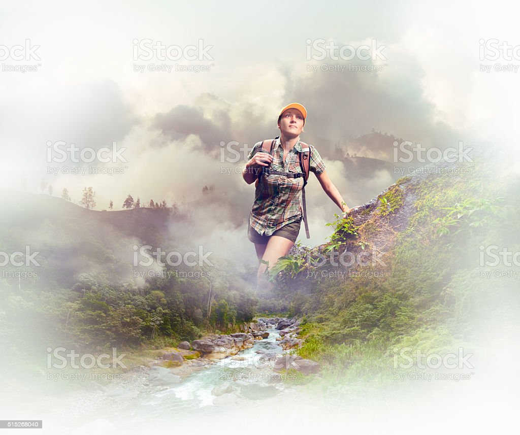woman tourist with a backpack walking in the rain forest stock photo