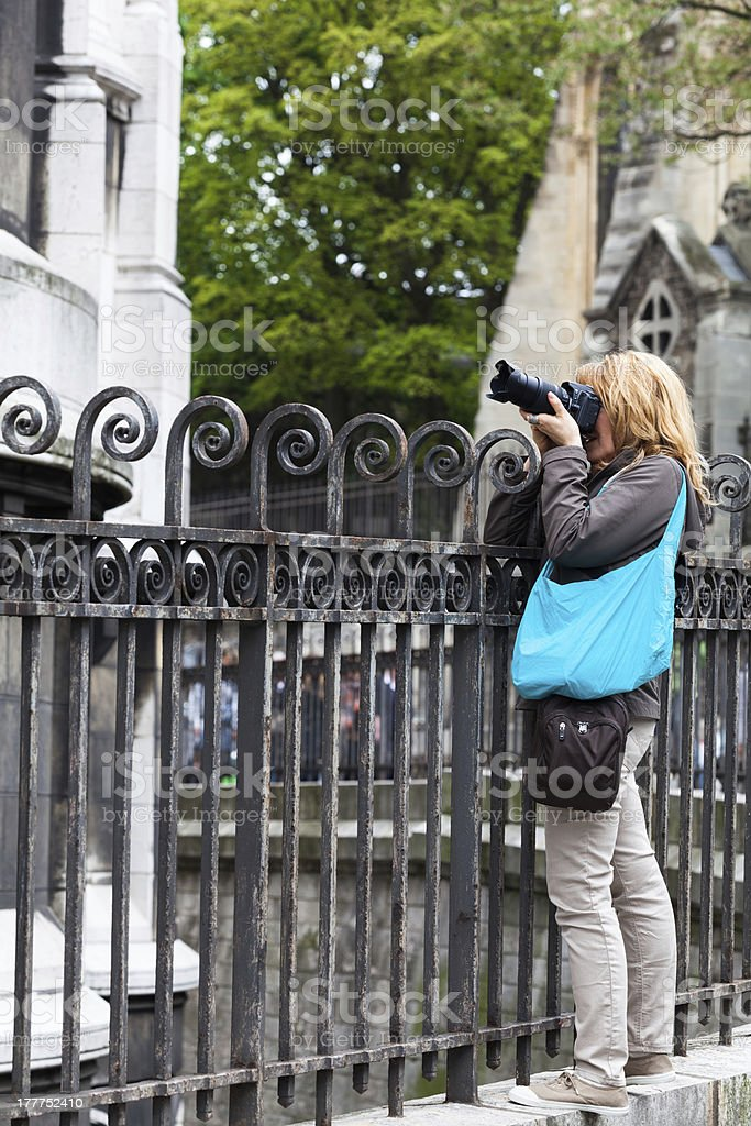 Woman Tourist with Camera in  Montmartre stock photo
