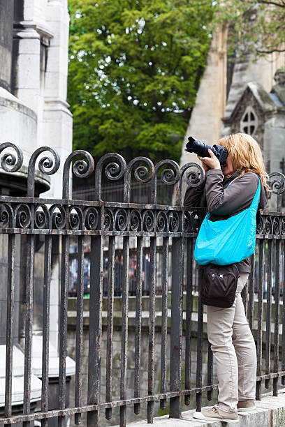 woman tourist with camera in  montmartre - carolinemaryan stock pictures, royalty-free photos & images
