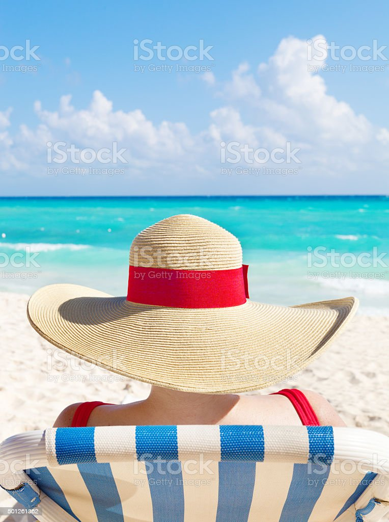 Woman Tourist with Sun Hat on Tropical Beach Cancun Mexico stock photo