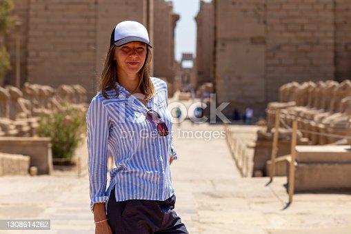 Woman touriston on excursions in Karnak Temple. Luxor, Egypt