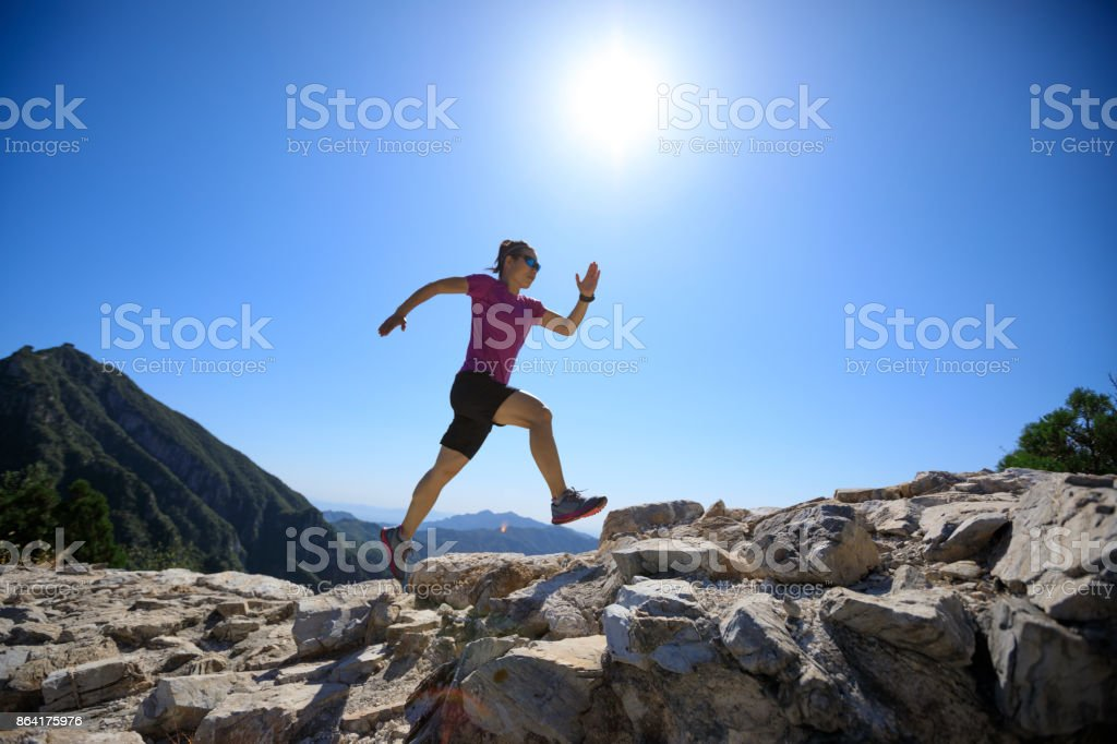 woman trail runner running at great wall on the top of mountain royalty-free stock photo