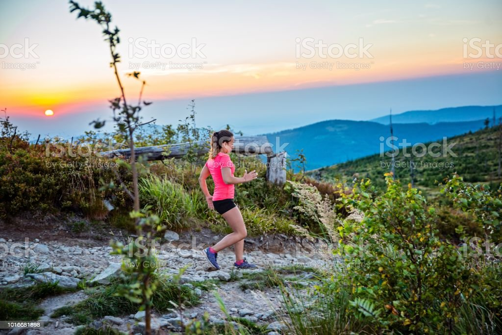 reputable site d5ee2 681cb Woman Trail Running In Mountains - Fotografie stock e altre ...