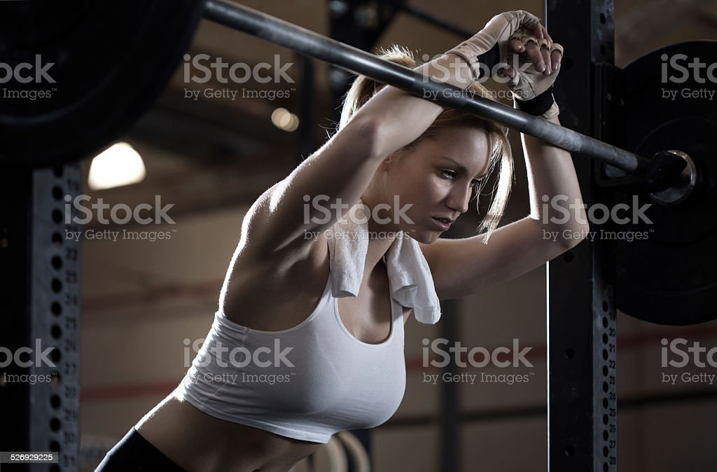 Woman training at gym center stock photo