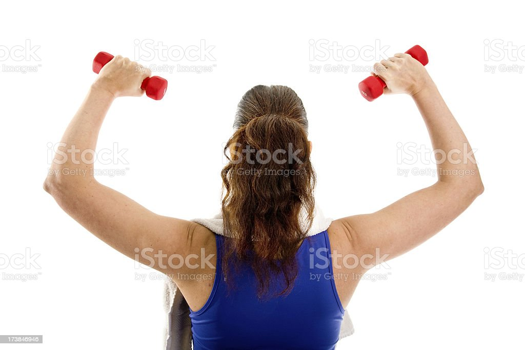 Woman training her arms with dumbbells stock photo