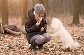 Woman training her dog in the park